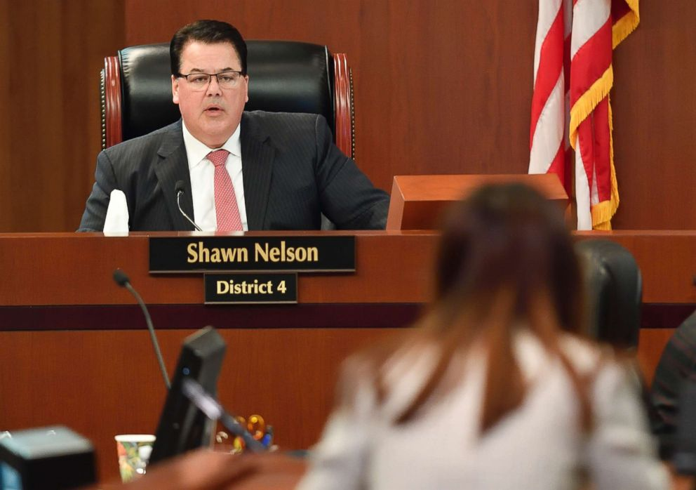 PHOTO: Orange County Supervisor Shawn Nelson responds to a speaker during the public comment section of the Orange County Board of Supervisors meeting in Santa Ana, Calif. on Mar 27, 2018.