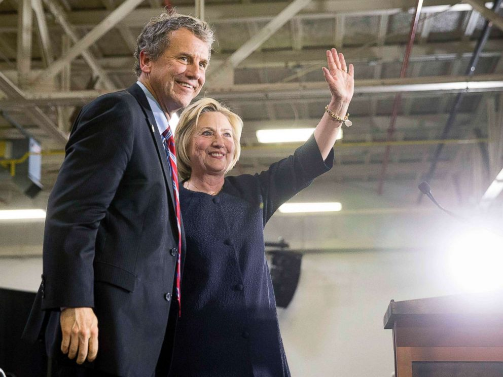PHOTO: Democratic presidential candidate Hillary Clinton waves to supporters as she stands on stage with Sen. Sherrod Brown, D-Ohio, left, after speaking at a rally in Cleveland, June 13, 2016.