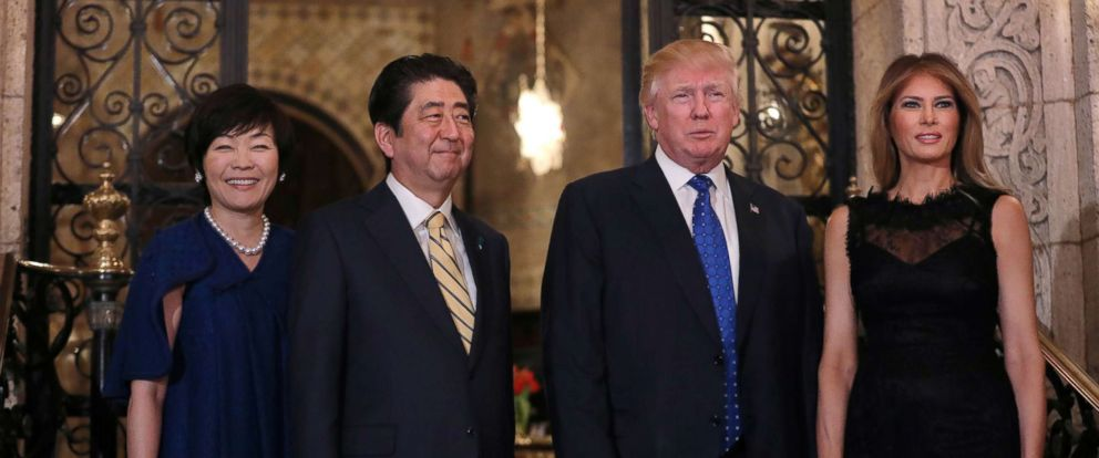 PHOTO: President Donald Trump, First Lady Melania Trump, right, Japanese Prime Minister Shinzo Abe and his wife Akie Abe, left, pose before attending dinner at Mar-a-Lago Club in Palm Beach, Fla., Feb. 11, 2017.
