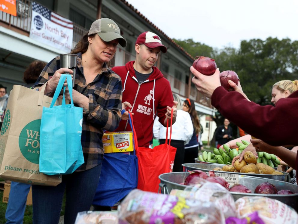 PHOTO: U.S. Coast Guard families receive fresh produce during a food giveaway on Jan. 19, 2019 in Novato, Calif.