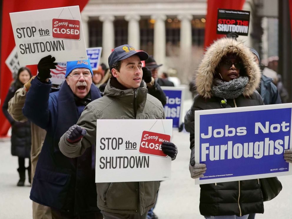 PHOTO: People hold placards during a rally to protest against the partial government shutdown at Federal Plaza in Chicago, Jan. 18, 2019.