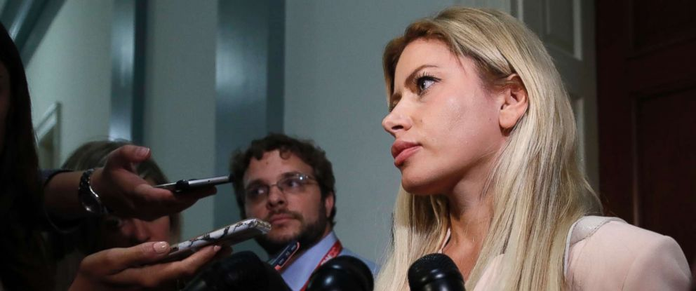 File photo of Simona Mangiante Papadopoulos, wife of former Donald Trump campaign adviser George Papadopoulos, speaking to members of the media after attending a meeting with Democrats on the House intelligence committee, July 18, 2018, in Washington.