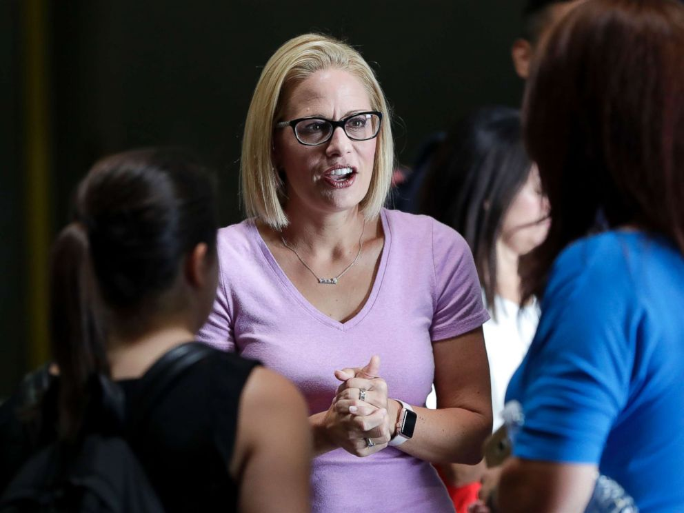 PHOTO: U.S. Senatorial candidate U.S. Rep. Kyrsten Sinema, D-Ariz., speaks with volunteers in Phoenix, Aug. 21, 2018.