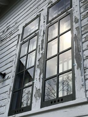 PHOTO: Paint is seen cracked and chipped along the window and siding of the Sleeping Bear Point Coast Guard Station Maritime Museum.