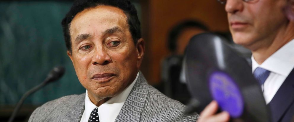 PHOTO: Singer Smokey Robinson looks at a music record being used as an example during a Senate Judiciary Committee hearing on music protections, May 15, 2018, on Capitol Hill in Washington.
