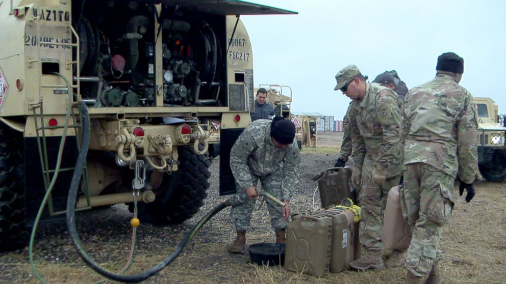 PHOTO: U.S. Army soldiers fuel up gas tanks.