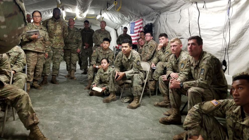 PHOTO: Army soldiers listen to a lecture in a medical clinic tent at Base Camp Donna.