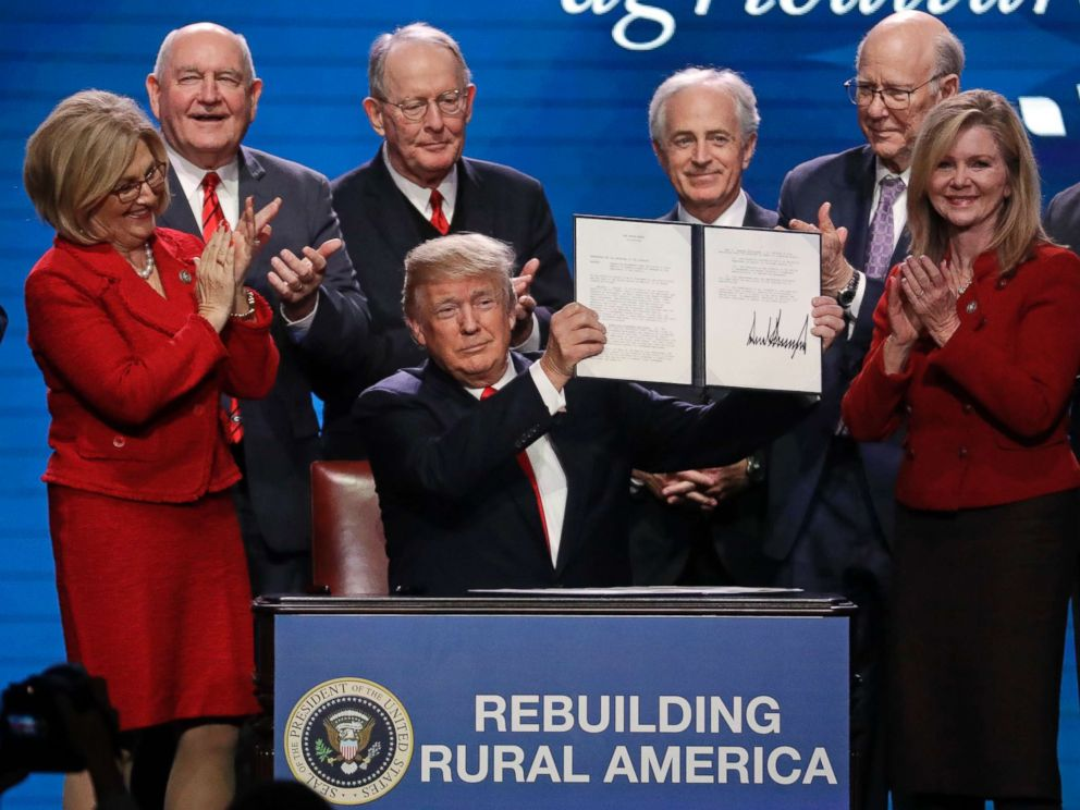 PHOTO: President Donald Trump holds up an executive order after signing it at the American Farm Bureau Federation annual convention Monday, Jan. 8, 2018, in Nashville, Tenn.