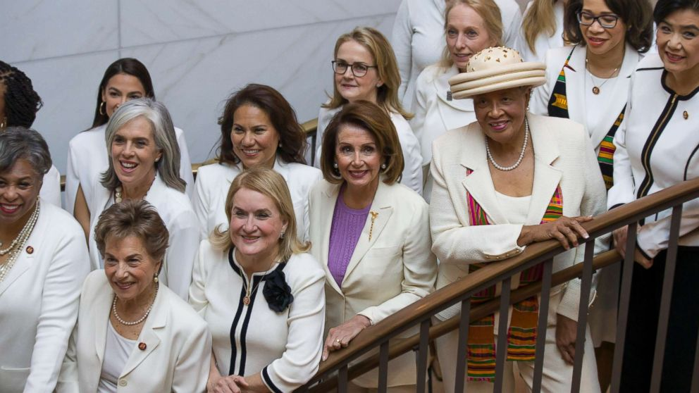 House Speaker Nancy Pelosi is joined by other women wearing white, as they pose for a group photo before the State of the Union address by President Donald Trump, on Capitol Hill, Feb. 5, 2019, in Washington.