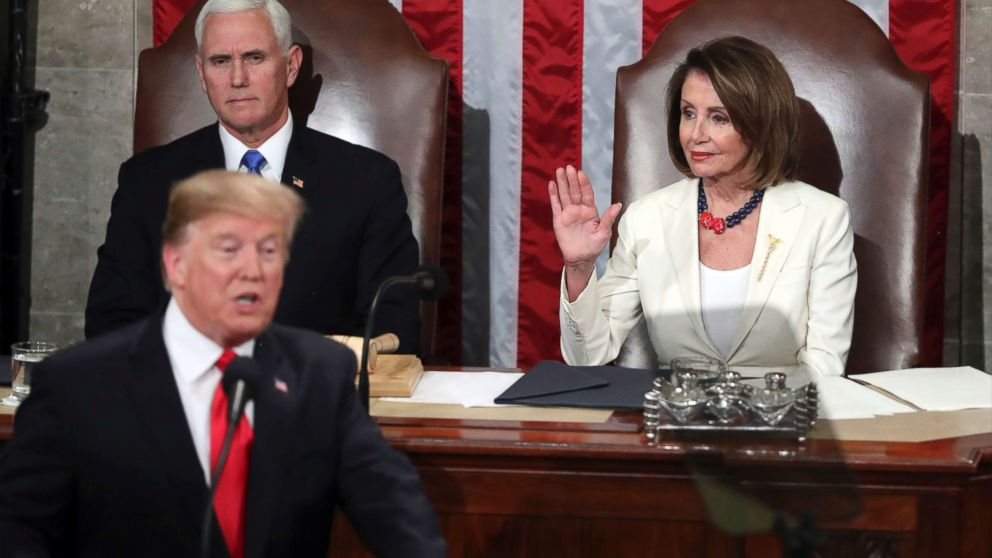 Speaker of the House Nancy Pelosi raises her hand in a gesture to quiet the Democrats as President Donald Trump delivers his State of the Union address to a joint session of Congress on Capitol Hill in Washington, Feb. 5, 2019.