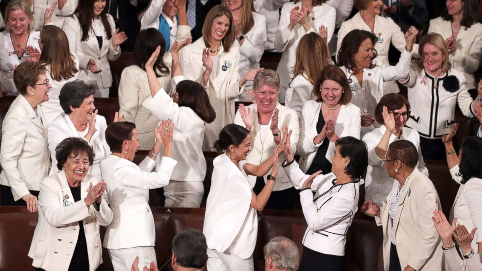 Female lawmakers cheer during President Donald Trump's State of the Union address in the chamber of the U.S. House of Representatives on Feb. 5, 2019, in Washington.