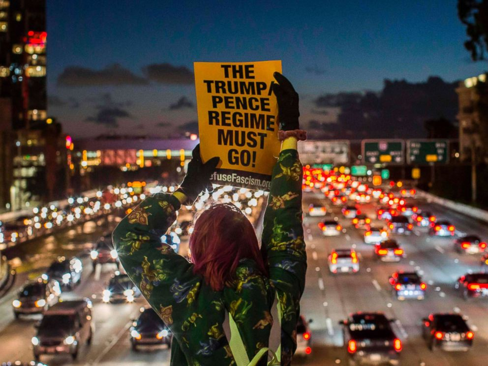 PHOTO: Protestors shout slogans and hold signs during the State of the Union protest on a freeway overpass in downtown Los Angeles, Feb. 05, 2019.