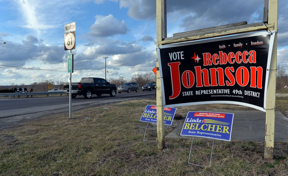 PHOTO: Campaign signs for both candidates for Kentuckys 49th District, Republican Rebecca Johnson and Democrat Linda Belcher, share space on a road in Shepherdsville, Ky., Feb. 20, 2018.