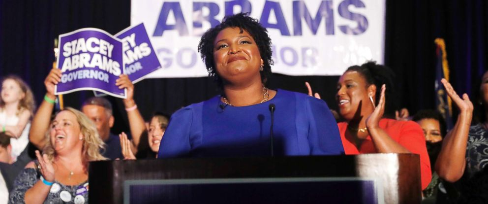 PHOTO: Georgia Democratic gubernatorial candidate Stacey Abrams smiles before speaking to supporters during an election-night watch party, May 22, 2018, in Atlanta.