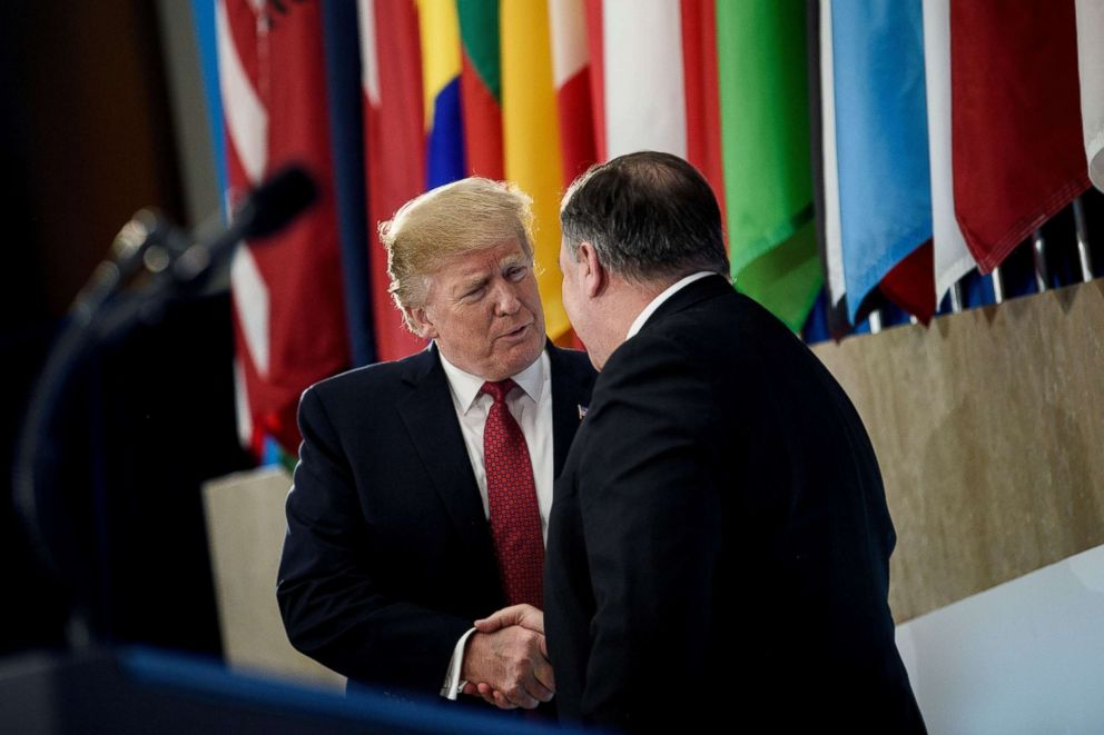 PHOTO: President Donald Trump is greeted by Secretary of State Mike Pompeo before speaking to the Ministers of the Global Coalition to Defeat ISIS at the Department of State, Feb. 6, 2019, in Washington, D.