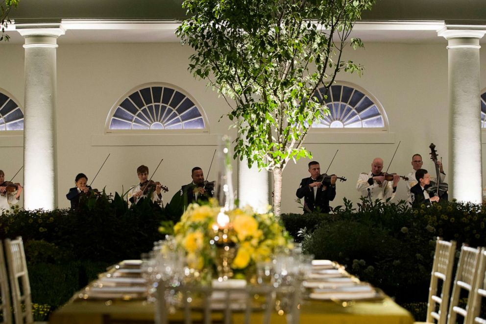 PHOTO: A table is set as a military band plays during a media preview for the State Dinner with President Donald Trump and Australian Prime Minister Scott Morrison in the Rose Garden of the White House, Sept. 19, 2019, in Washington.