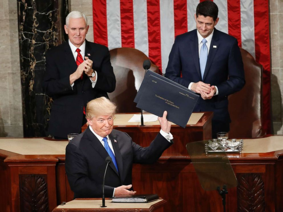 PHOTO: President Donald Trump holds up copies of his speech upon arrival and before delivering his State of the Union address to a joint session of Congress on Capitol Hill in Washington, Jan. 30, 2018.