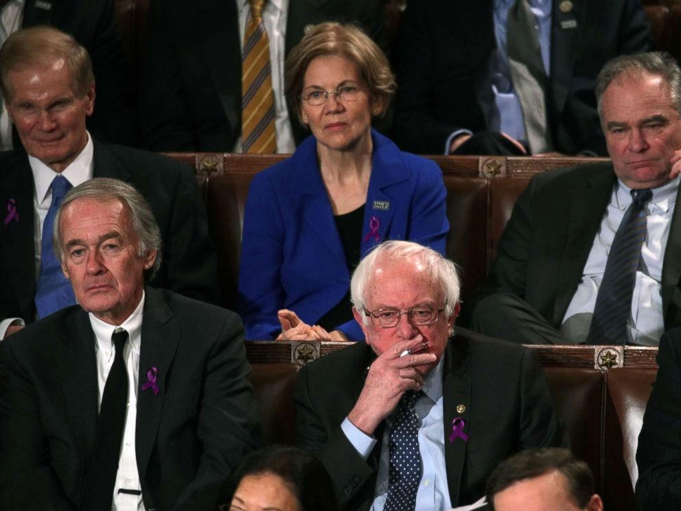 PHOTO: Senator Bernie Sanders, center, watches President Trump during the State of the Union address, January 30, 2018 in Washington, DC.