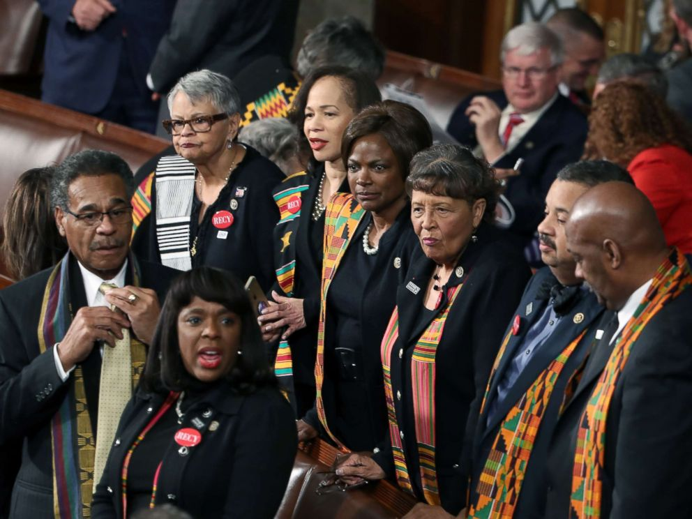 PHOTO: Members of Congress wear black clothing and Kente cloth in protest before the State of the Union address in the chamber of the U.S. House of Representatives Jan. 30, 2018 in Washington.