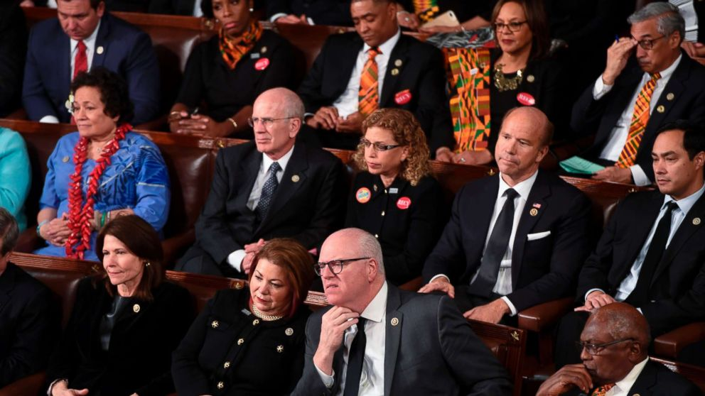 Democratic Senators, House representative, and guests sit and look on as President Donald Trump delivers the State of the Union address at the US Capitol in Washington, Jan. 30, 2018.