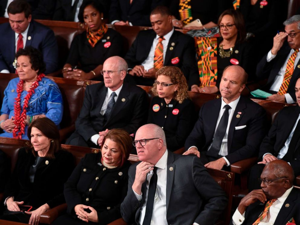 PHOTO: Democratic Senators, House representative, and guests sit and look on as President Donald Trump delivers the State of the Union address at the US Capitol in Washington, Jan. 30, 2018.