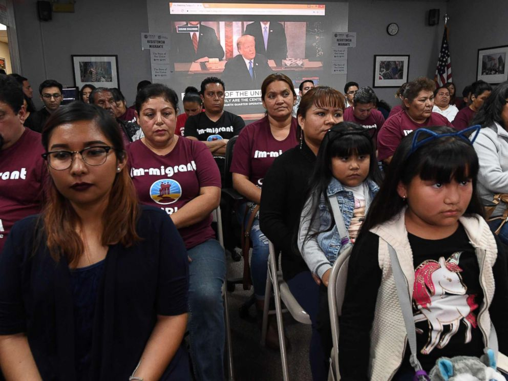 PHOTO: DACA recipients and their supporters turn their back on an image showing President Trump during a State of the Union party at the Coalition for Humane Immigrant Rights and the California Dream Network offices in Los Angeles, Jan. 30, 2018.