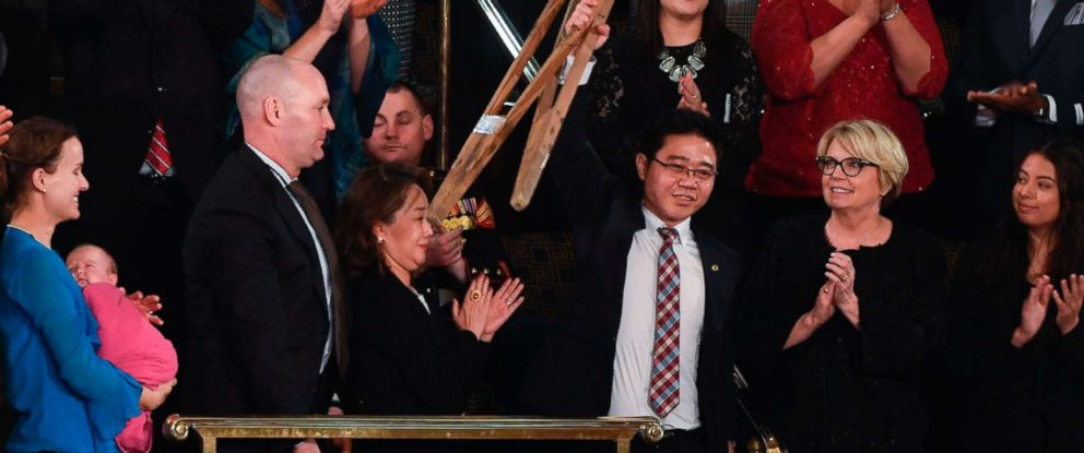 PHOTO: North Korean defector Ji Seong-ho raises his crutches as President Donald Trump delivers his State of the Union address at the US Capitol in Washington, on Jan. 30, 2018.