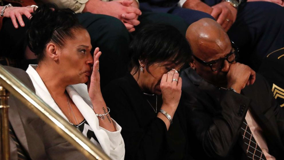 Elizabeth Alvarado, Robert Mickens, Evelyn Rodriguez, and Freddy Cuevas, parents of two girls who were chased down and murdered and whose deaths were among a string of 17 Long Island slayings that have been attributed to MS-13, cry as U.S. President Donald Trump introduces them during his State of the Union address in Washington, Jan. 30, 2018.