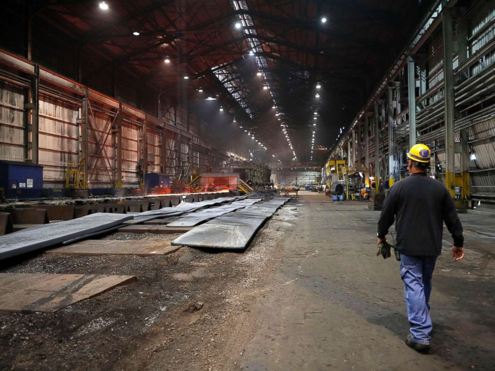PHOTO: In this June 28, 2018, file photo, a worker walks inside the hot-strip mill at the U.S. Steel Granite City Works facility in Granite City, Ill.