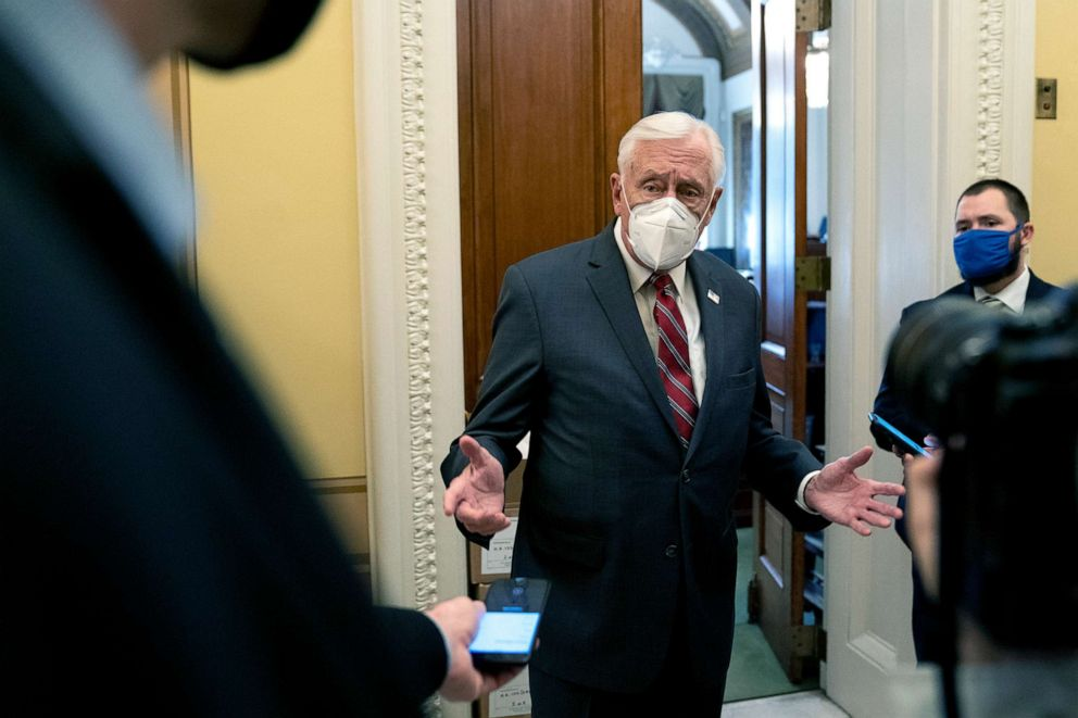 PHOTO: House Majority Leader Steny Hoyer wears a proactive mask while speaking to reporters at the Capitol, Jan. 11, 2021.