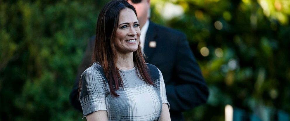 PHOTO: Stephanie Grisham,spokeswoman for first lady Melania Trump, watches as President Donald Trump and the First Lady greet attendees during the annual Congressional Picnic on the South Lawn on June 21, 2019, in Washington.