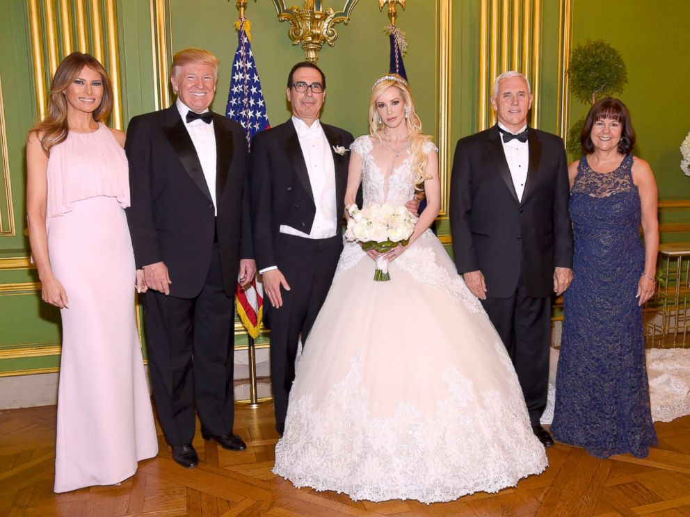 First lady Melania Trump, President Trump, Secretary of the Treasury Steven Mnuchin, Louise Linton, Vice President Pence, and Karen Pence pose at the wedding of Steven Mnuchin and Louise Linton, June 24, 2017 at Andrew Mellon Auditorium in Washington.