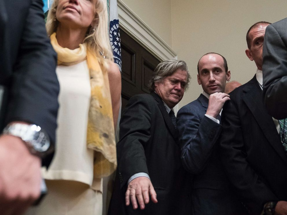 PHOTO: Steve Bannon stands with other senior White House staff as President Donald Trump and others unveil legislation to place new limits on legal immigration in the Roosevelt Room of the White House in Washington, Aug 02, 2017.