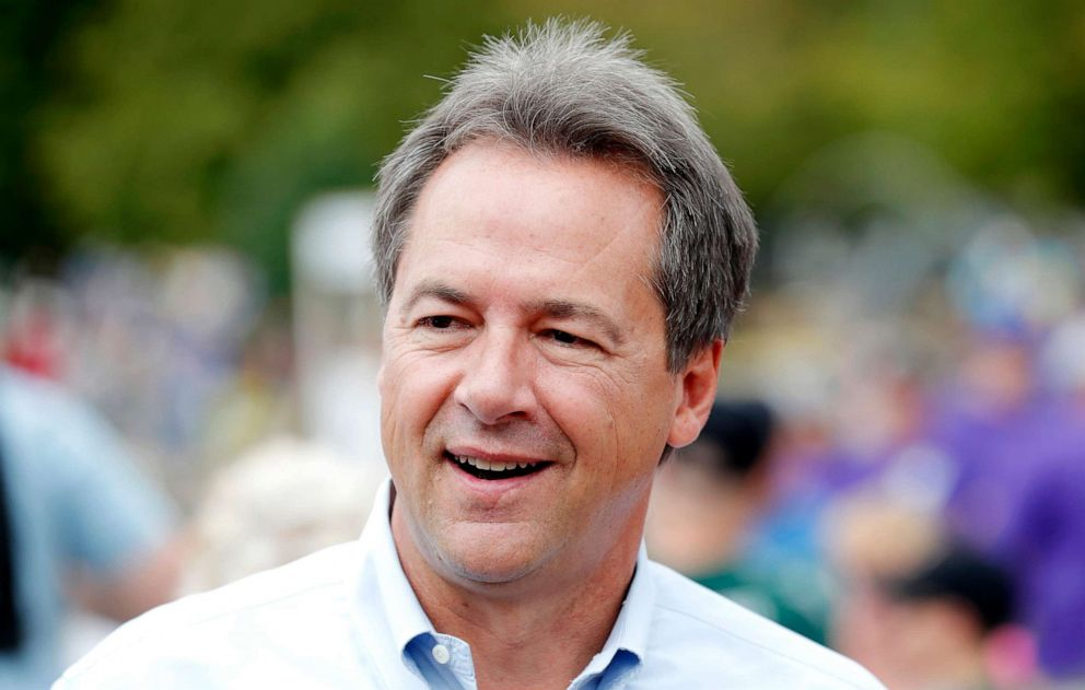 PHOTO: Montana Gov. Steve Bullock walks down the main concourse during a visit to the Iowa State Fair, Thursday, Aug. 16, 2018, in Des Moines, Iowa.