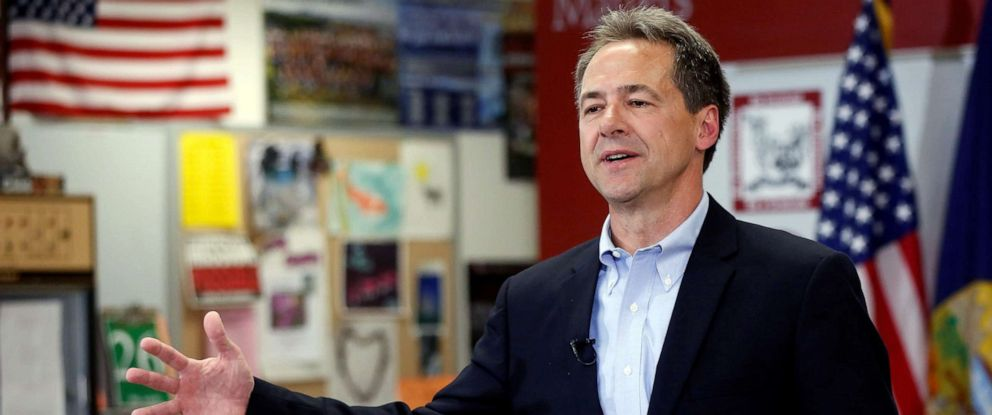 PHOTO: Montana Governor Steve Bullock talks to the media and students at Helena High School in Helena, Mont., May 14, 2019.