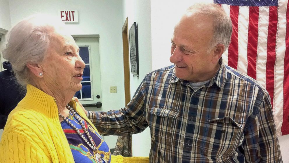 Precinct official Elaine Rex, of Odebolt, Iowa, talks with U.S. Rep. Steve King, of Kiron, Iowa, at the Odebolt Fire Station, where King cast the precinct's first vote in the mid-term election in Odebolt on Tuesday, Nov. 6, 2018.
