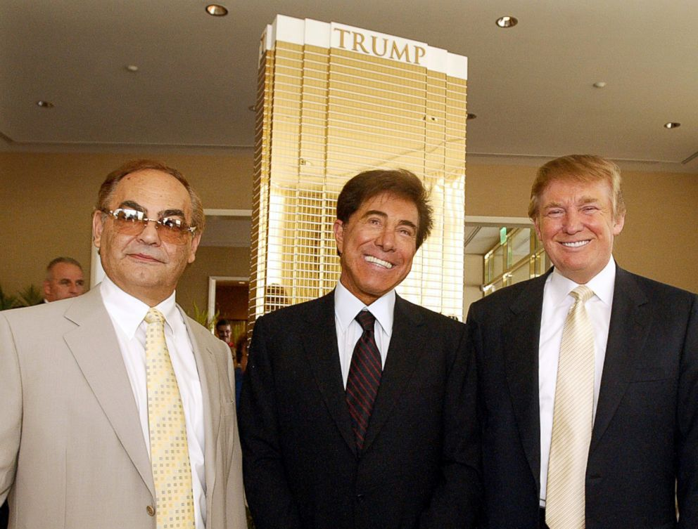 """Kansas billionaire businessman Phil Ruffin, left, poses with Las Vegas developer Steve Wynn, and Donald Trump, right, July 12, 2005 in Las Vegas in front of a model of the 64-story hotel and apartment tower that Trump and Ruffin will build on the Las Vegas Blvd. """"strip,""""  across from Wynn's new hotel and casino."""