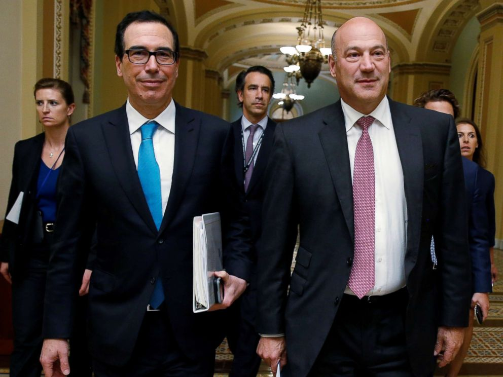 PHOTO: Secretary of the Treasury Steven Mnuchin and Director of the National Economic Council Gary Cohn walk after meeting with Republican law makers about tax reform on Capitol Hill, Sept. 12, 2017.