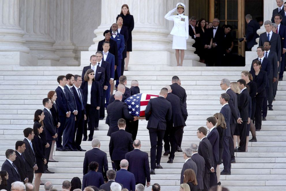 PHOTO: Members of the U.S. Supreme Court police serving as pallbearers carry the casket of the late Associate Justice John Paul Stevens through a cordon of former law clerks and up the steps of the U.S. Supreme Court, July 22, 2019, in Washington, DC.