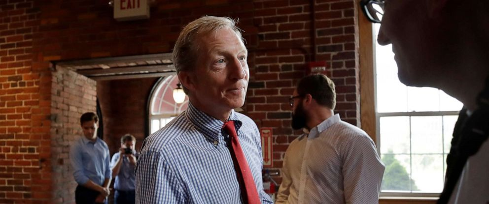 PHOTO: Democratic presidential candidate, businessman Tom Steyer shakes a hand during a campaign event, July 30, 2019, at the Waterworks Cafe in Manchester, N.H.