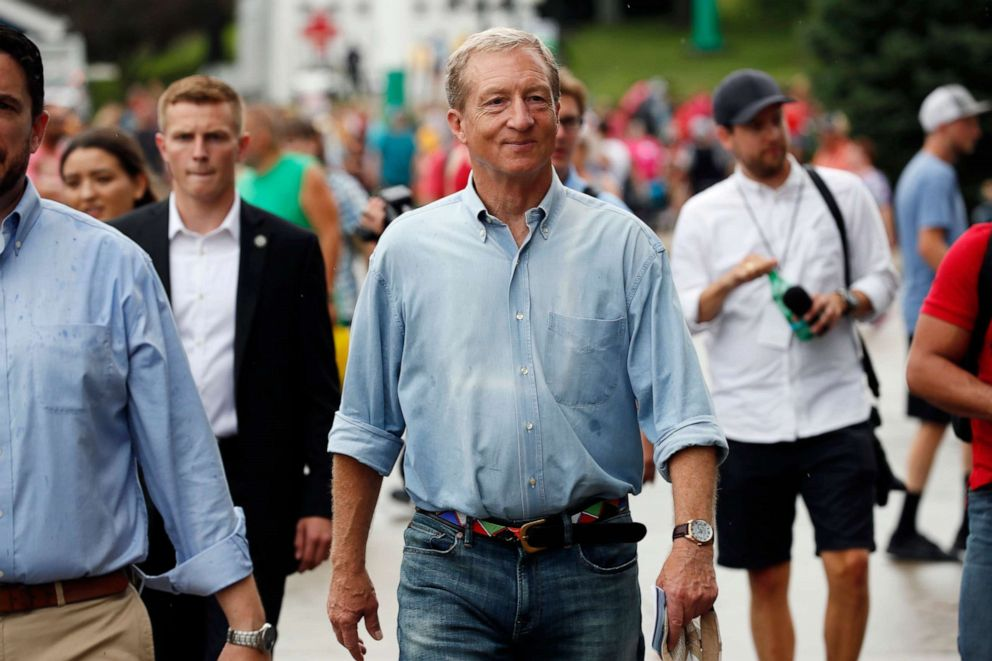 PHOTO: Democratic presidential candidate and businessman Tom Steyer walks down the grand concourse during a visit to the Iowa State Fair, Aug. 11, 2019, in Des Moines, Iowa.