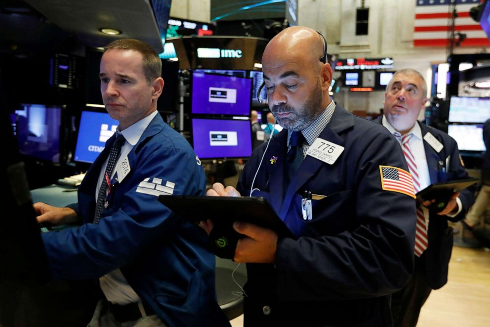 PHOTO: Specialist Stephen Naughton, left, works with trader Fred DeMarco on the floor of the New York Stock Exchange, Aug. 21, 2019.