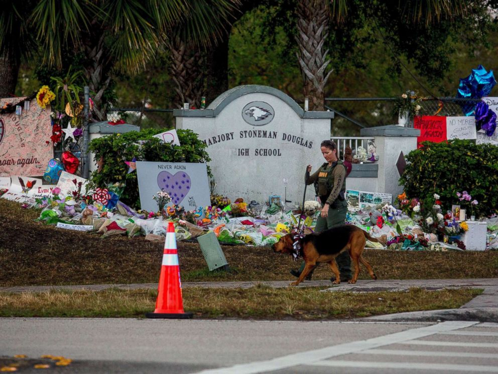 PHOTO: A Broward County sheriffs deputy with the K-9 unit patrols outside Marjory Stoneman Douglas High School in Parkland, Fla., as students arrive on Wednesday, Feb. 28, 2018.