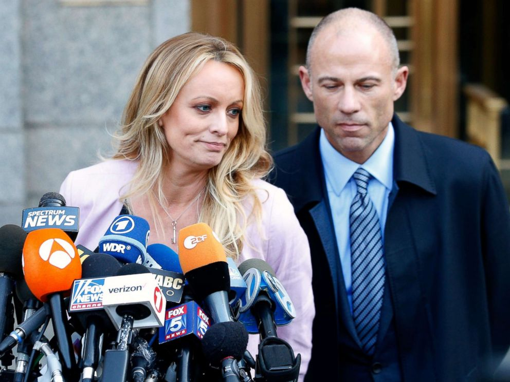 PHOTO: Adult film actress Stephanie Clifford, also known as Stormy Daniels, speaks to media along with lawyer Michael Avenatti (R) outside federal court in New York, April 16, 2018.