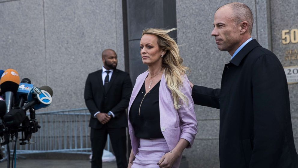 Stormy Daniels (Stephanie Clifford) and Michael Avenatti, attorney for Stormy Daniels, exit the courthouse, April 16, 2018 in New York City.