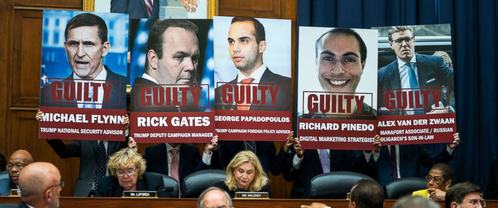 PHOTO: Congressional staff hold up pictures of people who have pled guilty in the Russia probe during a House Judiciary Committee and House Oversight and Government Reform Committee hearing in Washington, July 12, 2018.
