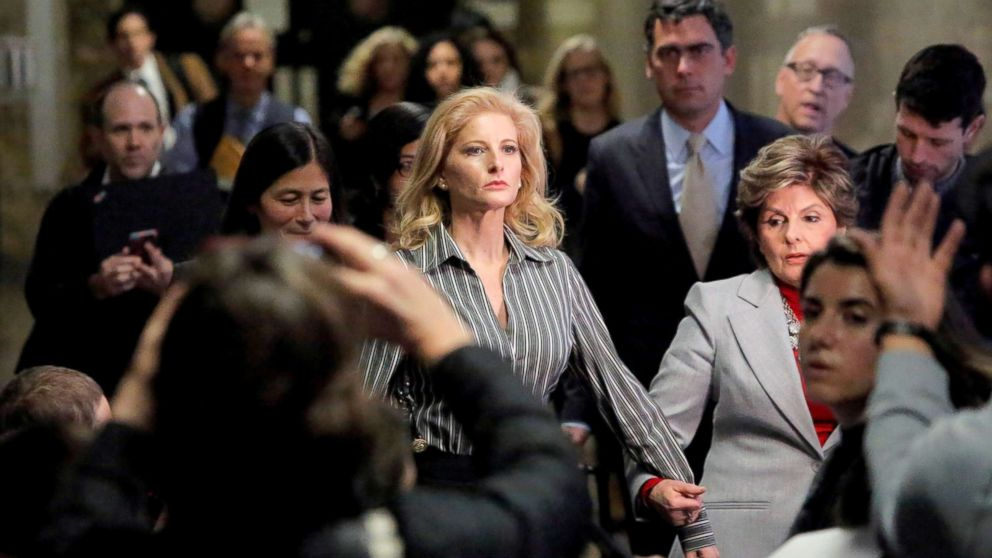 In this file photo, Summer Zervos, a former contestant on The Apprentice, leaves New York State Supreme Court with attorney Gloria Allred (R) after a hearing on the defamation case against President Donald Trump in Manhattan, New York City, Dec. 5, 2017.