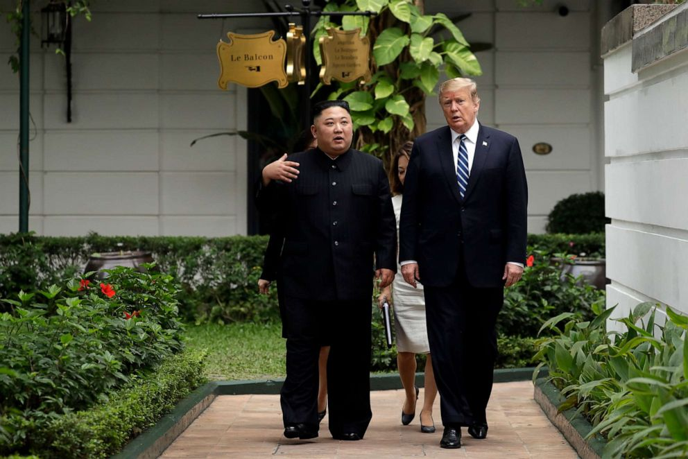 PHOTO: President Donald Trump and North Korean leader Kim Jong Un take a walk after their first meeting on Feb. 28, 2019, in Hanoi, Vietnam.