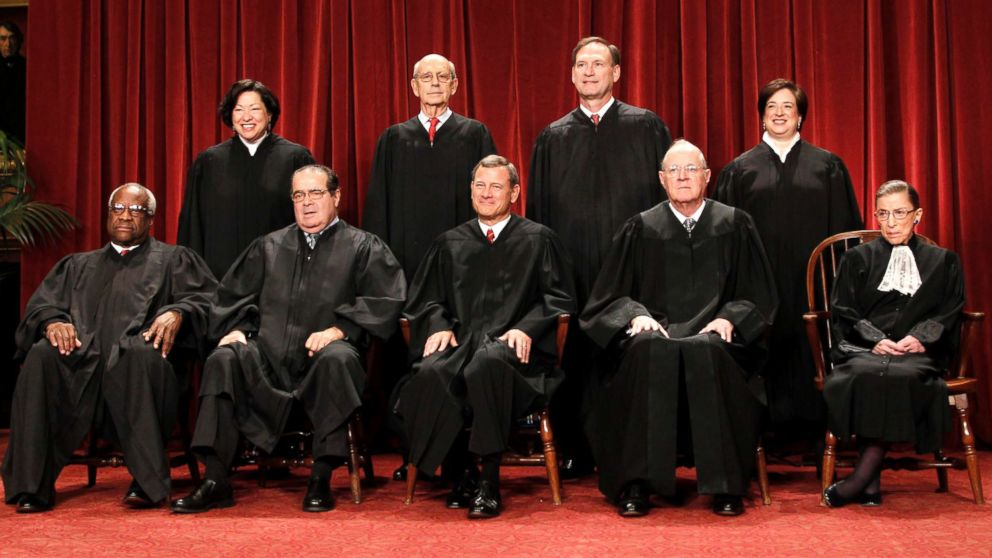 In this Oct. 8, 2010 file photo, members of the Supreme Court gather for a group portrait at the Supreme Court in Washington. Seated from left are: Associate Justices Clarence Thomas, Antonin Scalia, Chief Justice John Roberts, Associate Justices Anthony M. Kennedy, and Ruth Bader Ginsburg. Standing, from left are: Associate Justices Sonia Sotomayor, Stephen Breyer, Samuel Alito Jr., and Elena Kagan.