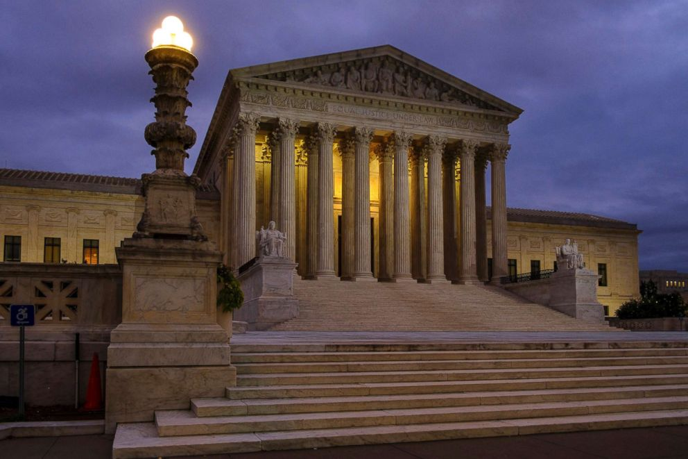 The U.S. Supreme Court building stands before dawn in Washington, D.C., Oct. 5, 2018.